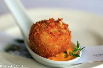 Basil arancini balls on a squash puree