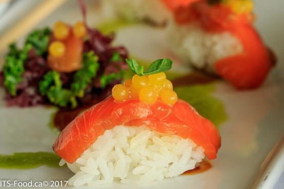 Salmon SashimiSour mango pearls, seaweed salad, steamed sticky rice, pea shoot vinaigrette