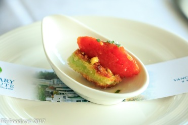 amuse bouche a fried green tomato with tomato confit and olive oil bubbles