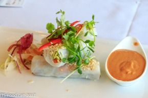 AppetizersDuck Confit Salad Rolltopped with sesame seed, served with crispy vegetables and spicy peanut sauce